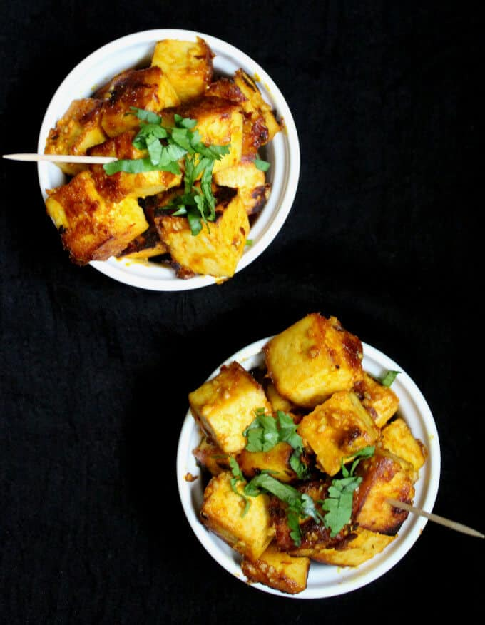 My Easy Mango Chipotle Glazed Tofu, with sparkling sweet, spicy, tangy and salty notes, makes a tasty and simple finger food for a full-blown event or a party of one. This recipe has only seven ingredients, and it takes under 20 minutes to put together. A vegan, nut-free and gluten-free recipe. #vegan #appetizer #fingerfood #mango #tofu #recipe #glutenfree #nutfree HolyCowVegan.net