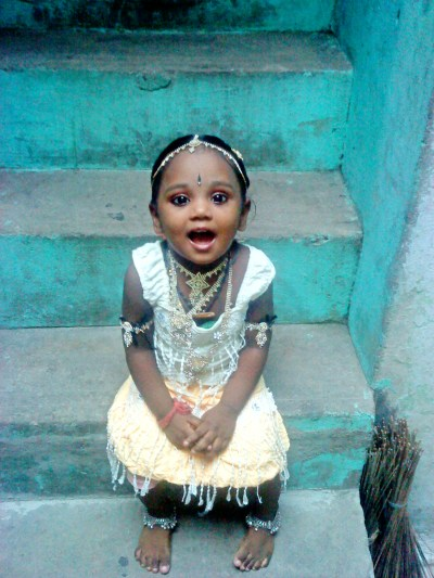 A small girl with an expression of surprise.
