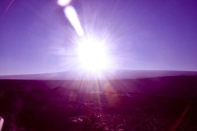 Sunset over Mauna Loa with deepened blues.
