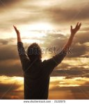 stock-photo-man-holding-arms-up-in-praise-against-golden-sunset-2122875