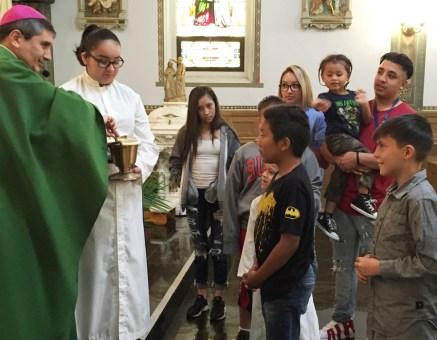 Bishop Jorge Rogriguez blesses the children