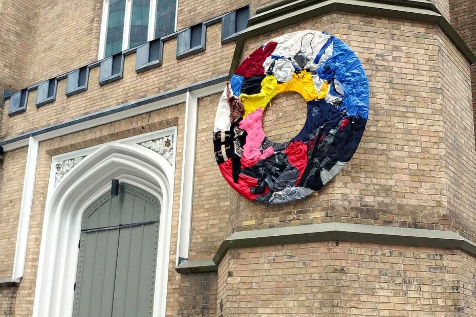 wreath of discarded clothing hanging on the southwest tower of Holy Trinity - photo by W. Whitla