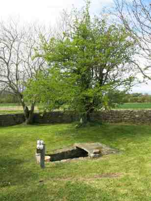 The well is partially covered by a slab