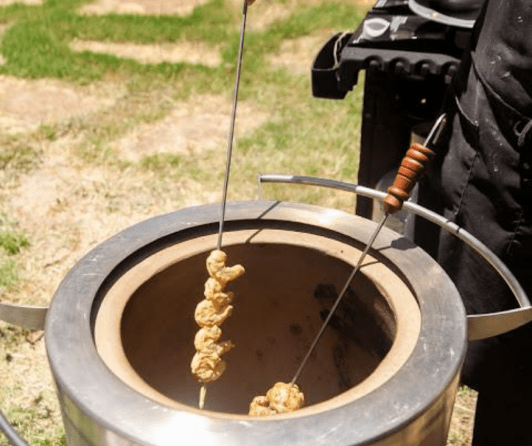skewered shrimp being cooked in hōmdoor tandoor oven