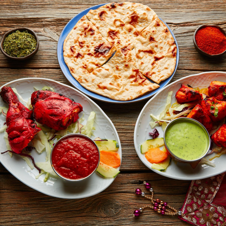 tandoori chicken and naan meal cooked in tandoor oven