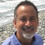 Anthony Bollotta on a beach