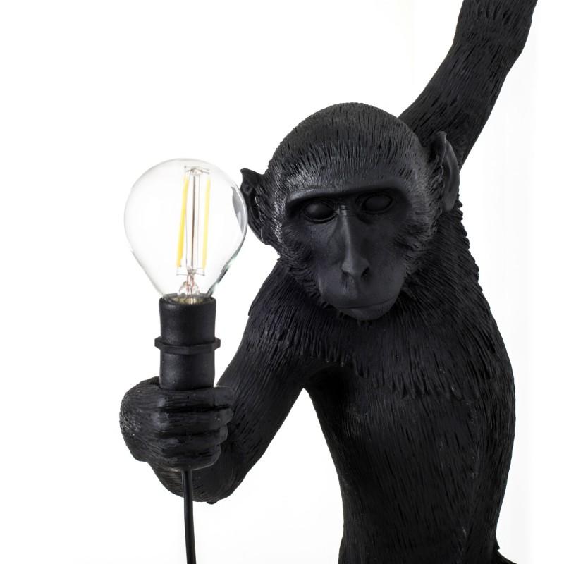 MONKEY LAMPENOIREAPPLIQUEDESIGNLAMPESINGESELETTIEN STOCK