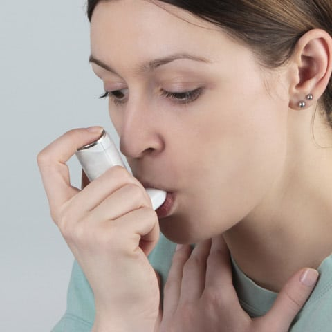 Photo of Girl Using an Asthma Inhaler