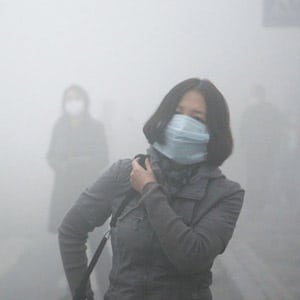 Photo of Woman Walking Around in Air Pollution