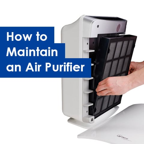 Photo of an air purifier being opened to replace filter