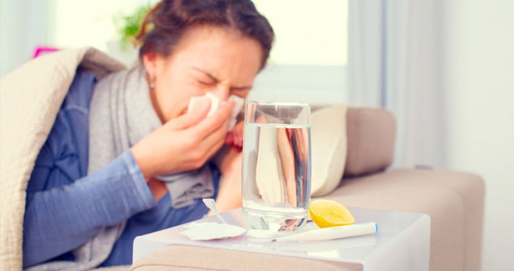 Photo of a Woman on Couch Sick with the Flu