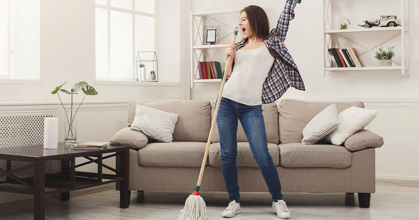 Photo of happy woman cleaning