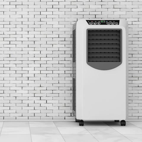 Photo of a Portable Air Conditioner Against a Wall