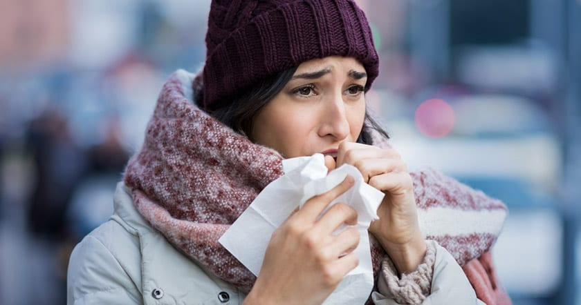 Winter Health & Wellness Tips Woman Coughing