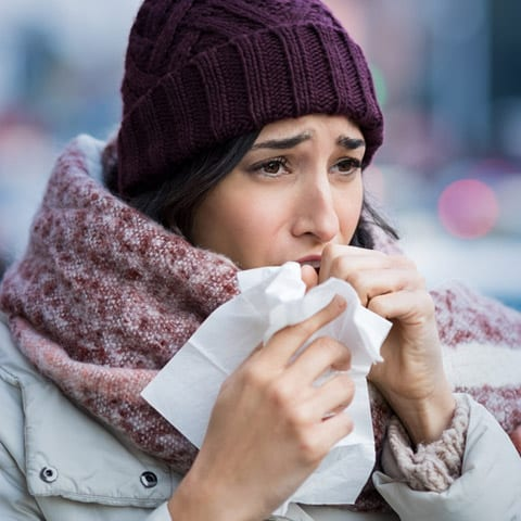 Photo of woman with winter allergies