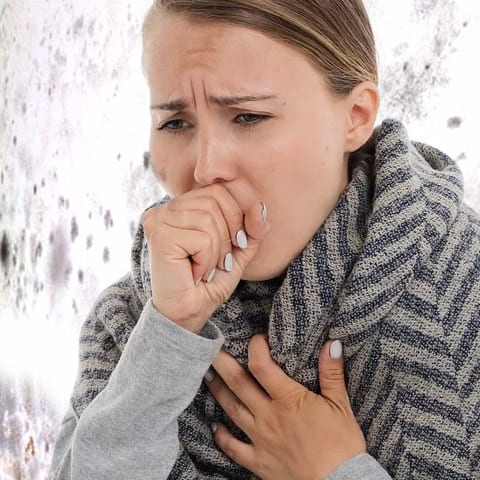 Photo of Woman Coughing from Mold