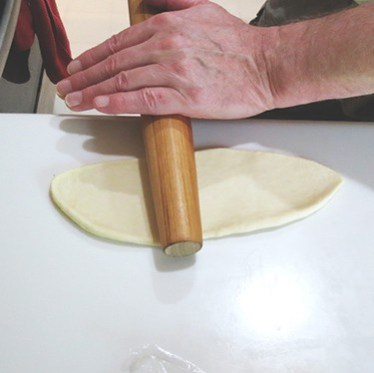 rolling out a ball of dough.