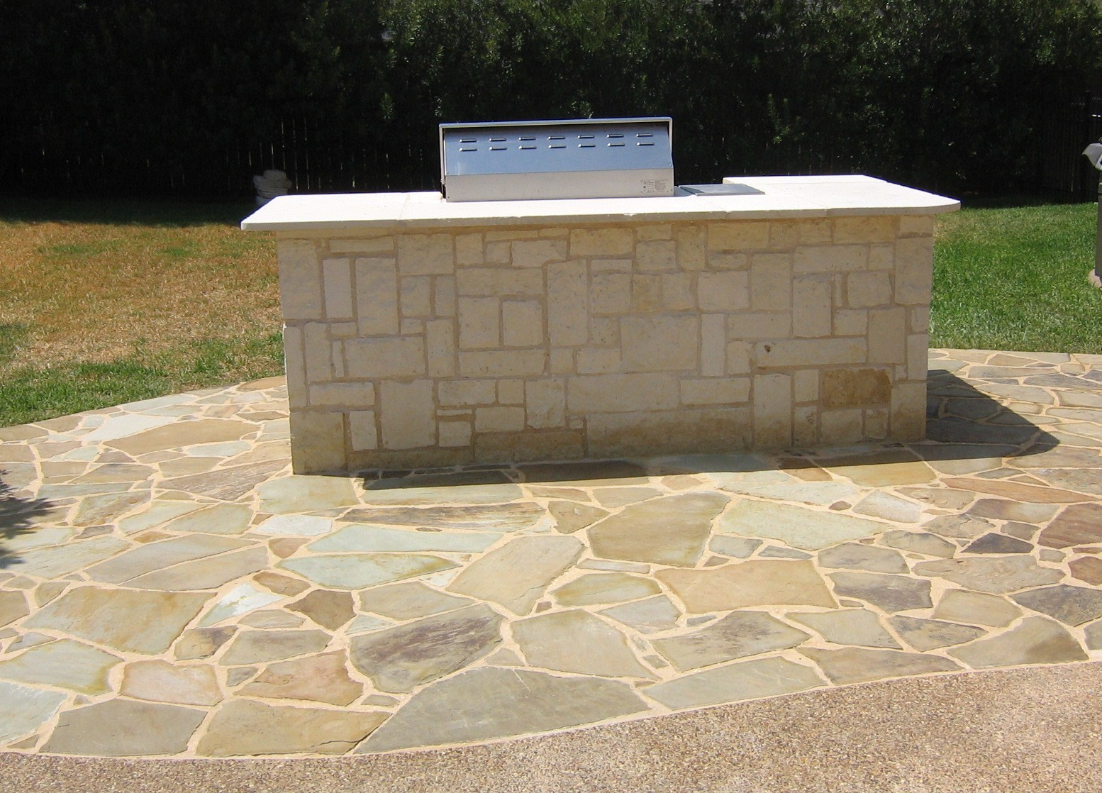 Flagstone patio  HOME AND LAWN TRANSFORMERS