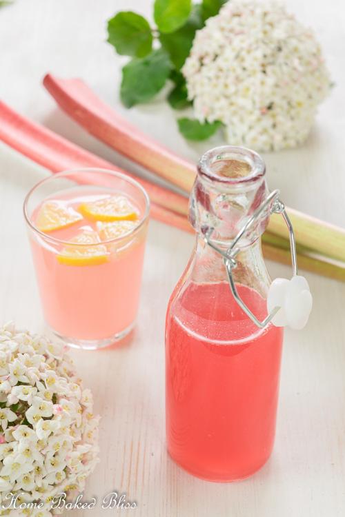 Rhubarb Syrup next to a glass of rhubarb lemonade