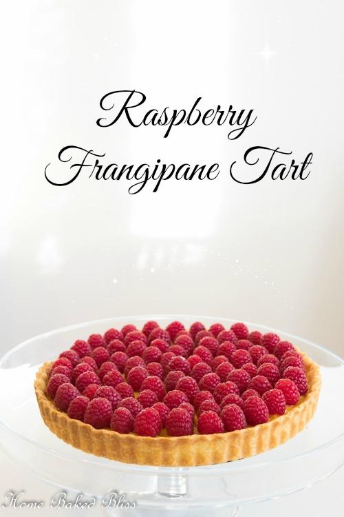 Raspberry Frangipane Tart on a glass cake stand