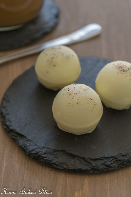 Cappuccino Truffles on a black stone plate.