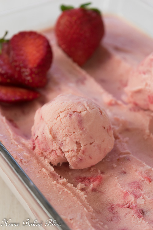 A scoop of homemade strawberry ice cream