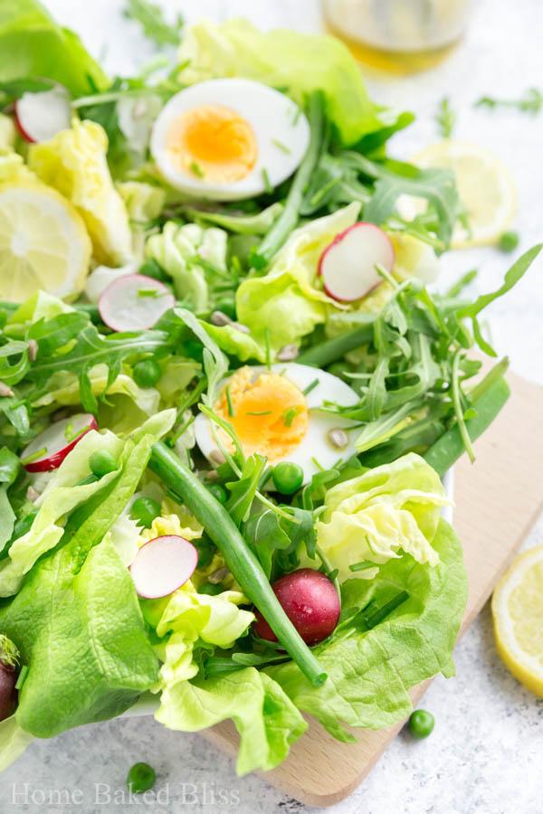 spring salad, spring salad recipe, salad with radishes, salad with eggs, salad with peas, salad with green beans, salad recipe, spring mix salad, spring mix salad recipe, crunchy salad recipe, crunchy salad, healthy salad recipe, awesome salad recipe, not boring salad recipe, Easter salad, Easter salad recipe, spring salad vinaigrette, olive oil and lemon vinaigrette