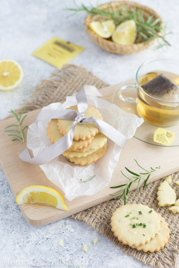 Rosemary lemon cookies packed in parchment paper and wrapped with a pink ribbon.