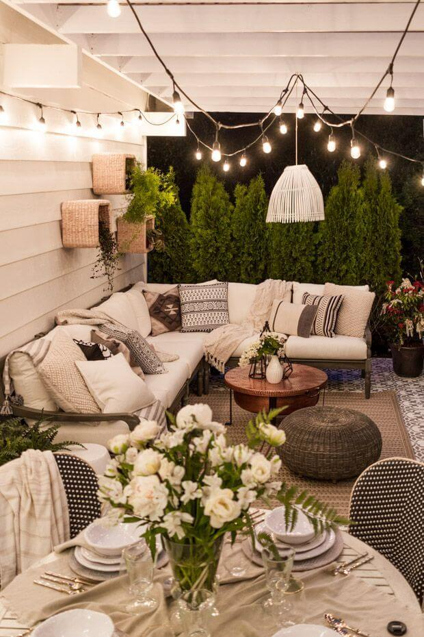 Clean White Walls, Fabric, and Bulbs Lighten this Outdoor Space
