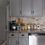 Dramatic Grey Cabinets Complement A Neutral Backsplash Homebnc