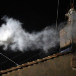 White smoke emerges from the chimney on roof of the Sistine Chapel to signify there is a new pope
