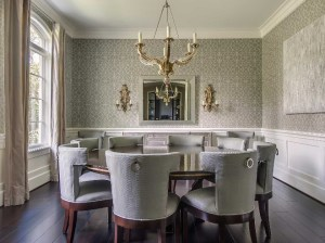 upper dining wainscoting grey lower walls clad gray interior trellis features alongside expansive illuminating lined chandelier velvet seats chairs round