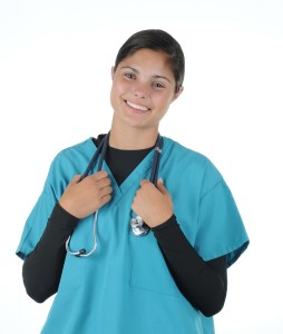 Smiling female medical professional in scrubs holding stethoscope