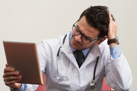stressed out doctor with no time to see patients, transform the healthcare system