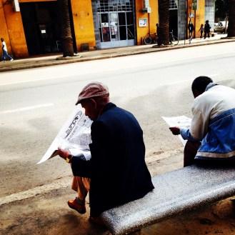 An elder caught scanning the Tigrinya-language newspaper, Haddas Ertra, in downtown Asmara, Eritrea on August 27, 2014.