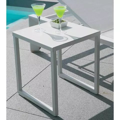 lounge chair small side table poolside