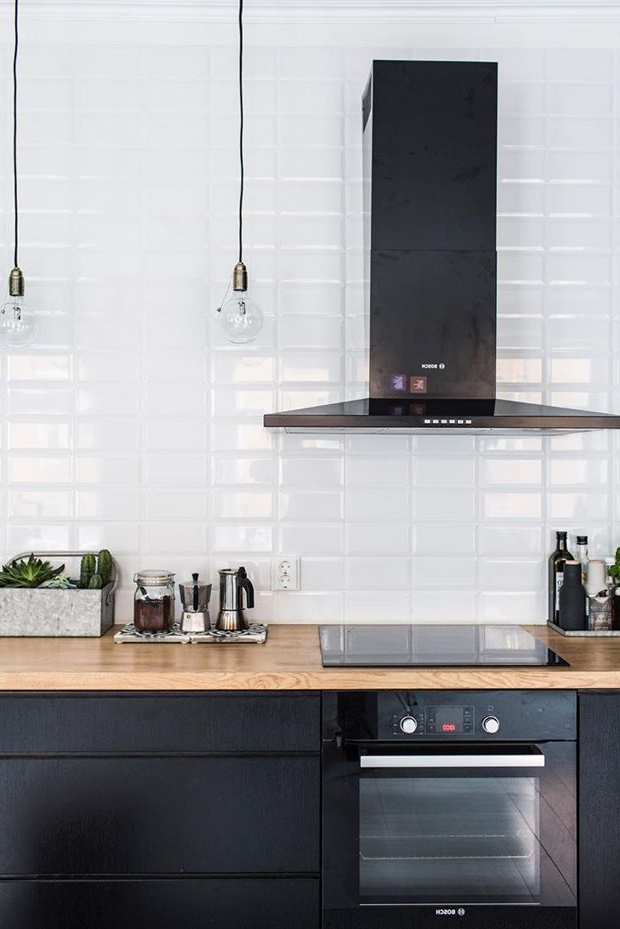 Black Kitchen Cabinets White Tiles And Wood Work Top In A Home In Helsinki Finland My