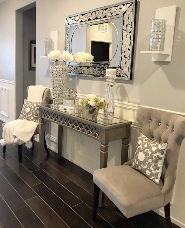 Console Table At The Bottoms Of The Stairs Welcoming You