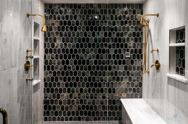 Elegant Walk In Shower Is Located Behind A Seamless Glass