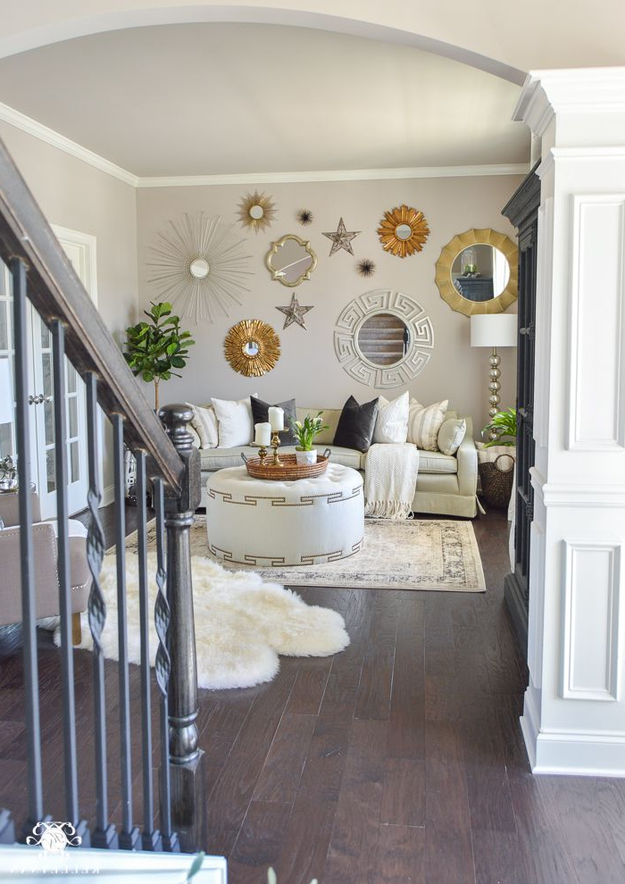 Gallery Wall Of Mirrors Above Living Room Sofa Decked And