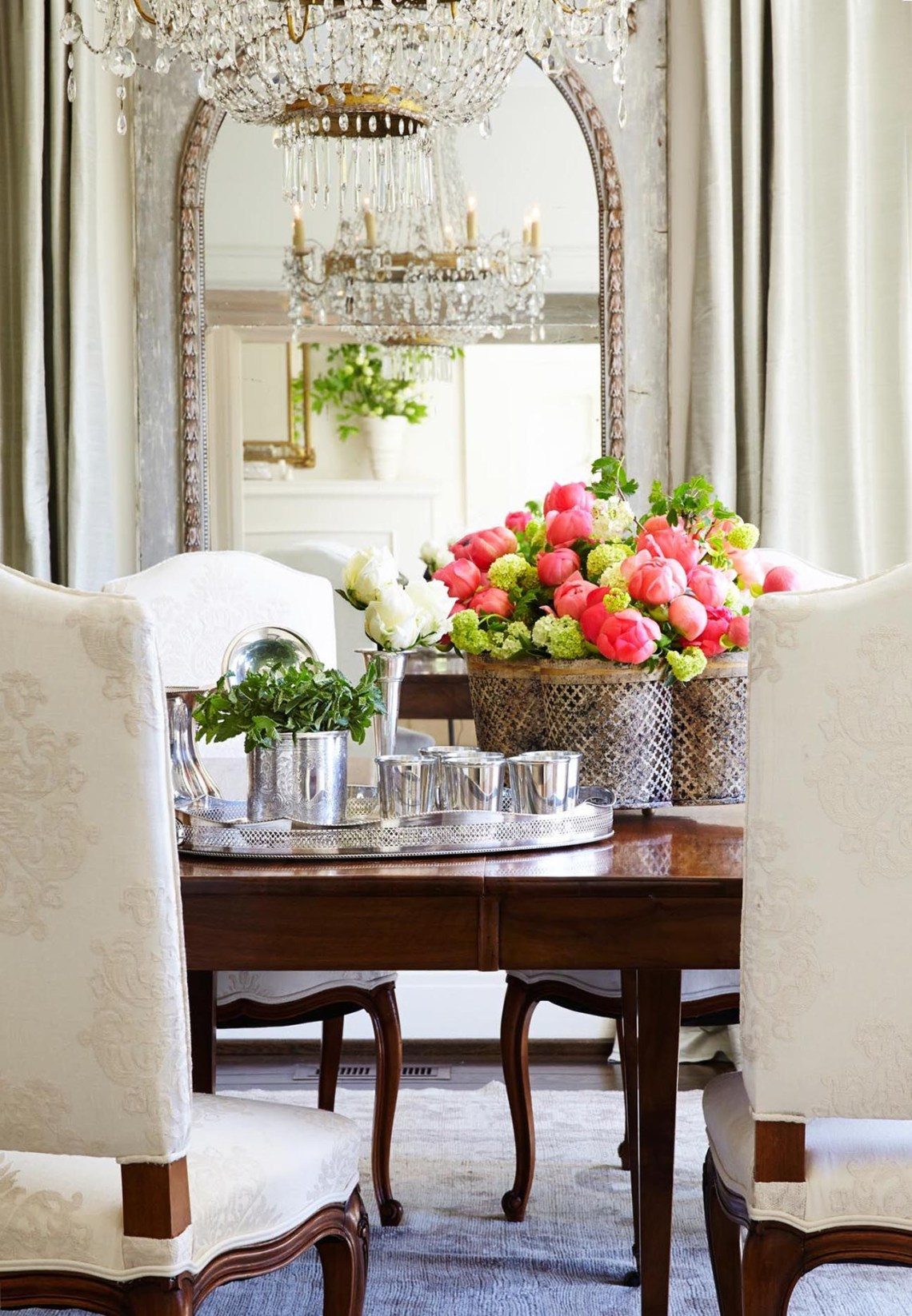 Niermann Weeks Quatrefoil Tole Planter Holds A Colorful Array Of Flowers In This Dining Room