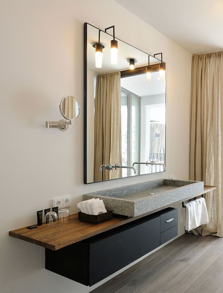 Warm Bathroom Interior With A Solid Natural Stone Sink