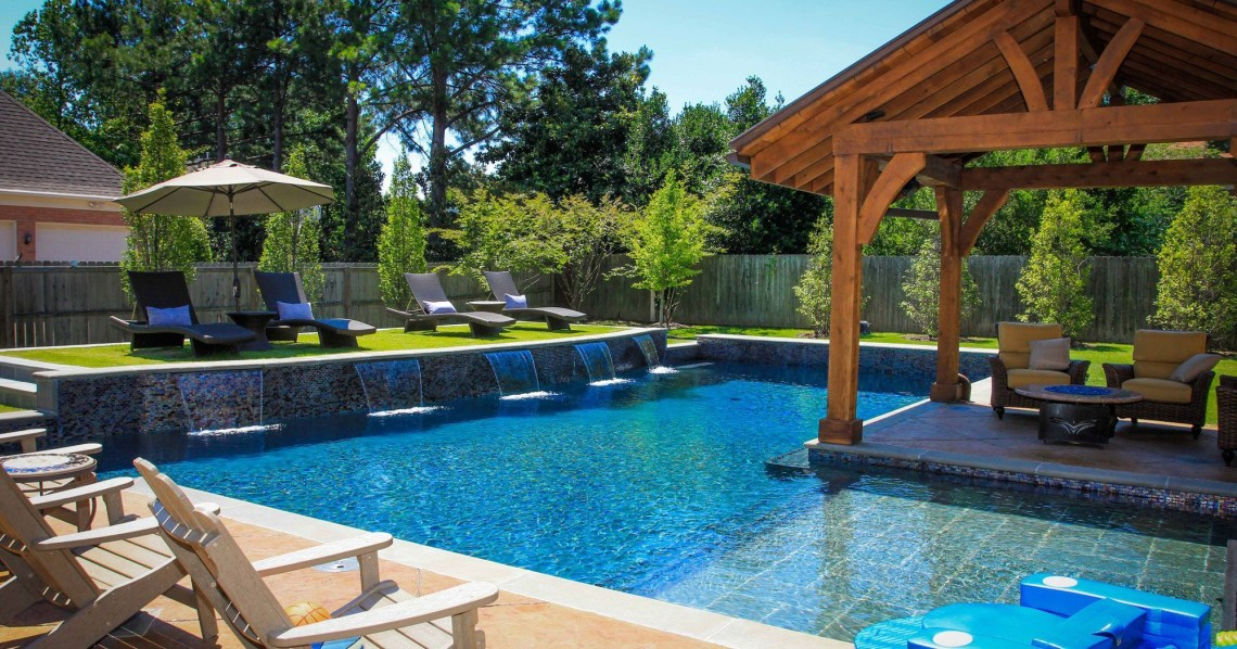 Wonderful Backyard Patio With Wooden Pool Lounge Chairs