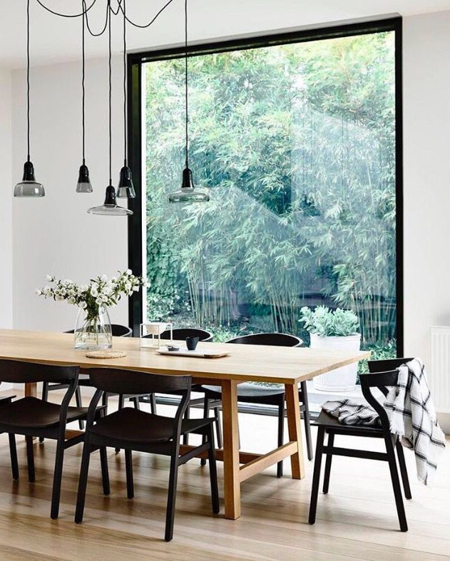 Wood Table With Black Chairs Wood Floor And White Walls