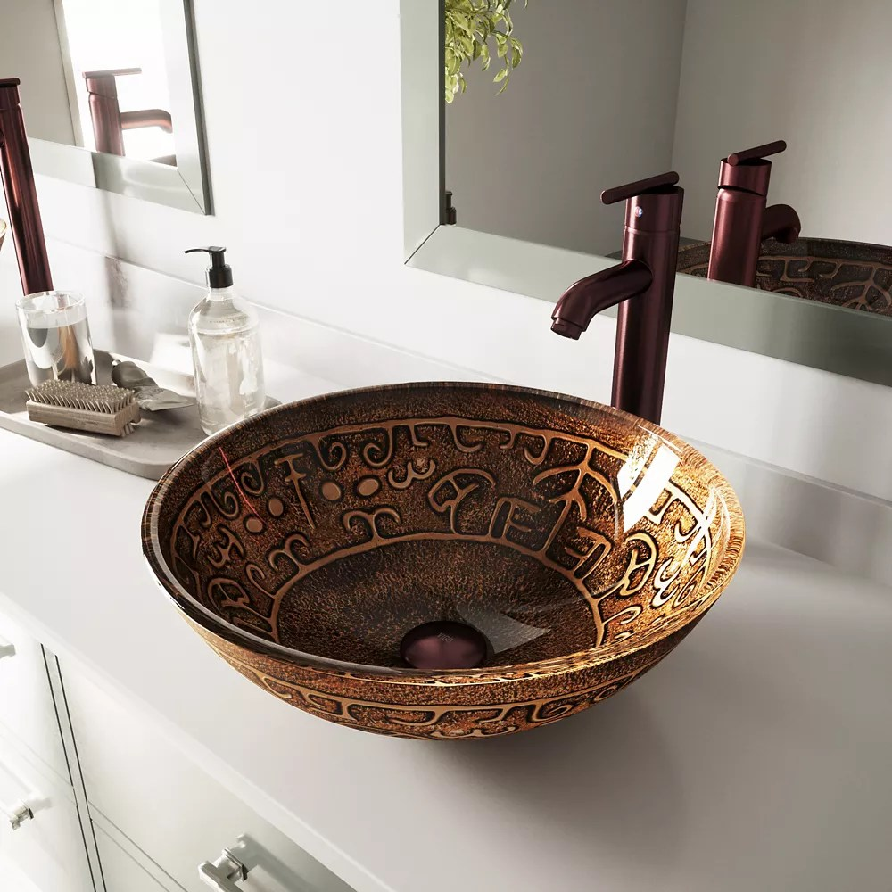 vessel bathroom sink in copper mosaic with faucet set in oil rubbed bronze