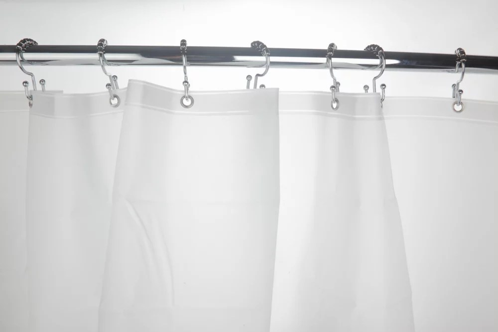 48 inch to 72 inch extendable curved shower rod in chrome with grey shower curtain and white liner
