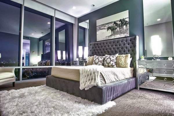 with mirrored furniture in the bedroom