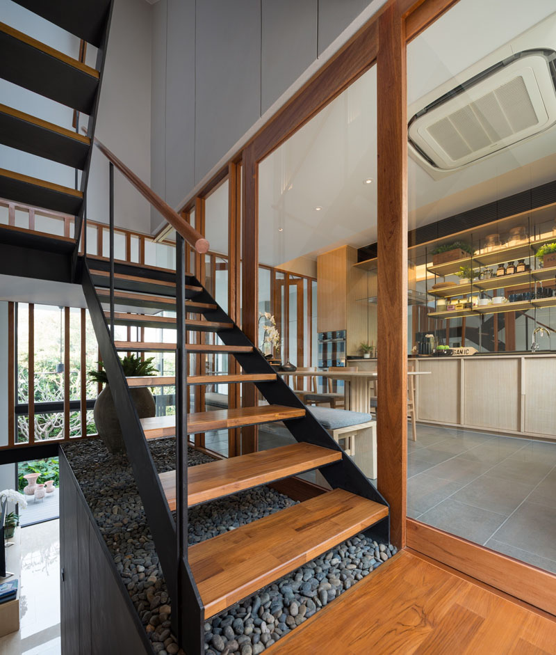 mirrored cabinets living room shelves with doors bespoke modern town house in thailand by baan puripuri ...