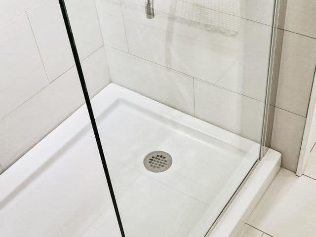 using spray foam under a shower pan