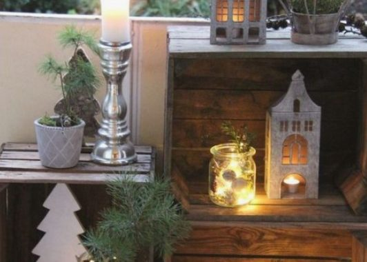 Pretty Winter Balcony Decor With Crates, Candle Lanterns, Moss And Evergreens, Deer And Plywood Trees